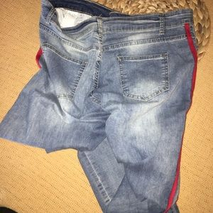 Jean with red strip on side legs